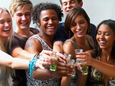 Young friends toasting drinks together